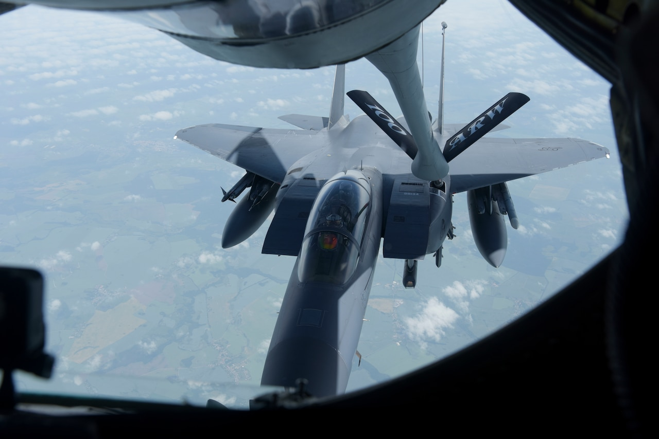 Aircraft refuels in mid-air.