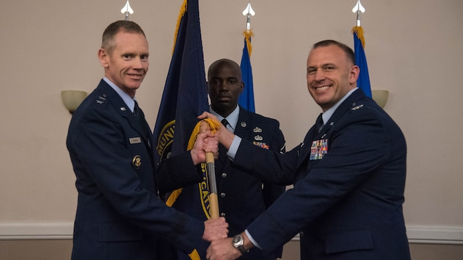 Col. Matthew W. McDaniel, right, incoming Standoff Munitions Application Center commander, receives the guidon from Maj. Gen. James C. Dawkins Jr., left, 8th Air Force and Joint-Global Strike Operations Center commander, during an assumption of command ceremony at Barksdale Air Force Base, Louisiana, August 9, 2019. SMAC is a mission planning cell within the J-GSOC that focuses on standoff weapons routing. The unit was activated Aug. 24, 2018. (U.S. Air Force photo by Airman Jacob B. Wrightsman)