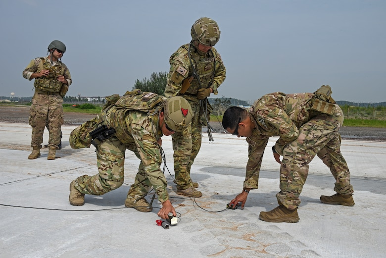 Members of the 8th Civil Engineer Squadron Explosive Ordnance Disposal unit conduct joint ordnance disposal training with the 38th Fighter Group at Kunsan Air Base, Republic of Korea, Aug. 22, 2019. More than 20 Airmen from the two units participated in the joint training, which challenged the EOD units to demonstrate how they would properly dispose of unexploded ordnance in various settings. (U.S. Air Force photo by Staff Sgt. Mackenzie Mendez)