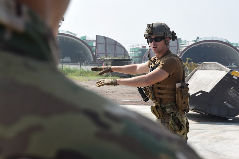 Staff Sgt. Zachary McCarthy, 8th Civil Engineer Squadron Explosive Ordnance Disposal technician, teaches how to properly clear unexploded ordnance during a joint training with the 38th Fighter Group EOD unit at Kunsan Air Base, Aug. 22, 2019. The training gave both the 8th CES and 38th FG EOD units the opportunity to share techniques and practice disposing of ordnance. (U.S. Air Force photo by Staff Sgt. Mackenzie Mendez)