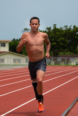 Jamie Brown, U.S. Paratriathlon National Team elite paralympic athlete, runs on the track Aug 12, 2019, on Kadena Air Base, Japan. Brown prepares for the Tokyo 2020 Paralympic Games by sticking to a strict workout regime along his teammates. (U.S. Air Force photo by Senior Airman Cynthia Belío)