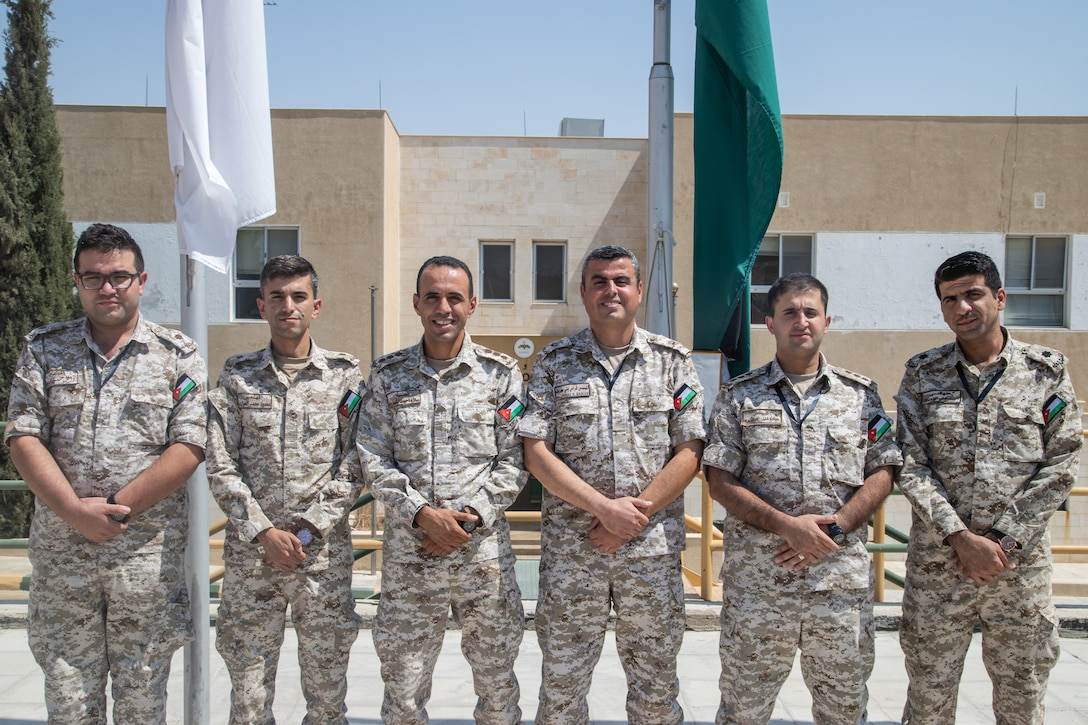 Jordan Armed Forces Maj. Esaid Feras (third from right), the cyber security officer for Eager Lion 19, and members of the JAF Cyber Incident Response Team pose for a photo Sept. 1, 2019, at the King Abdullah II Special Operations Training Center in Amman, Jordan. The cyber portion of EL19 was at its most robust this year. (U.S. Army National Guard photo by Cpl. Elizabeth Scott)