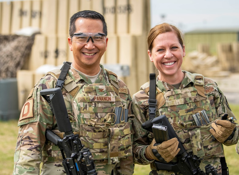 Chief Master Sgt. Kathi Glascock, 100th Air Refueling Wing command chief, and Col. Troy Pananon, 100th ARW commander, pose for a photo while participating in 100th Security Forces Squadron's advanced shoot, move and communicate training Aug. 30, 2019, on RAF Mildenhall, England. The 100th ARW command team makes a point of getting out around base and visiting Airmen, getting a taste of the work they do and talking with them to ask and answer questions they may have. (U.S. Air Force photo by Senior Airman Luke Milano)