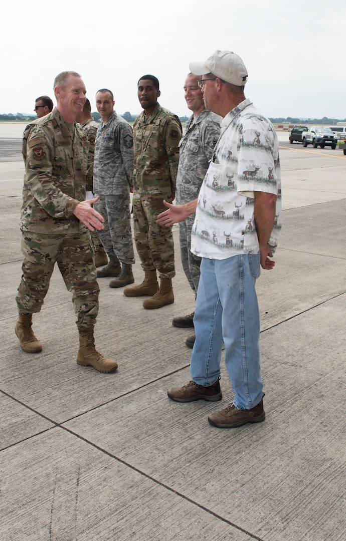 Major General James Dawkins Jr., Eighth Air Force commander, greets Michael Beaumeister, Air Force engineering and technical services representative assigned to Whiteman Air Force Base Missouri, on August 27, 2019, at Royal Air Force Fairford, England. Members of Team Whiteman, along with along strategic partners have deployed as part of a Bomber Task Force to the European Command area of operations to conduct theater integration and flying training. (U.S. Air Force photo by Staff Sgt. Kayla White)