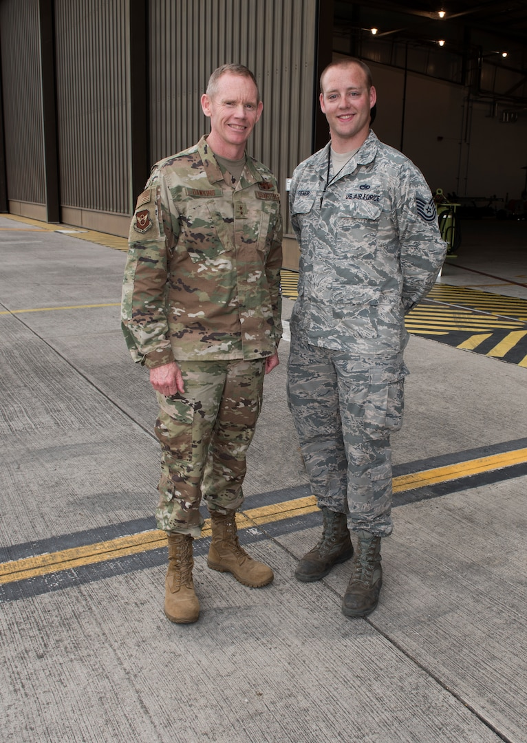 Major General James Dawkins Jr., Eighth Air Force commander, poses for a photo with Technical Sergeant Erik Riener, an aerospace ground equipment member assigned to the 509th Aircraft Maintenance Squadron at Whiteman Air Force Base, Missouri, on August 27, 2019, at Royal Air Force Base Fairford, England. Riener and other members of Team Whiteman, along with along strategic partners have deployed as part of a Bomber Task Force to the European Command area of operations to conduct theater integration and flying training. (U.S. Air Force photo by Staff Sgt. Kayla White)