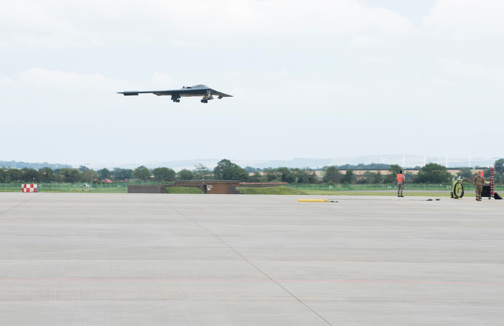 Major General James Dawkins Jr., Eighth Air Force commander, descends in a B-2 Spirit onto the flight line of Royal Air Force Base Fairford, England, on August 28, 2019. Dawkins flew the stealth bomber during his visit to engage with members of Whiteman Air Force Base, Missouri, who had deployed to Royal Air Force Fairford as a Bomber Task Force to conduct theater integration and flying training. (U.S. Air Force photo by Staff Sgt. Kayla White)