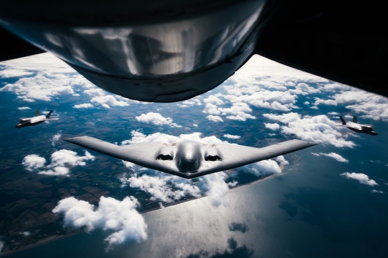 A U.S. Air Force 509th Bomb Wing B-2 Spirit is flanked by two United Kingdom Royal Air Force F-35 Lightning IIs during a Bomber Task Force training exercise over England, Aug. 29, 2019.