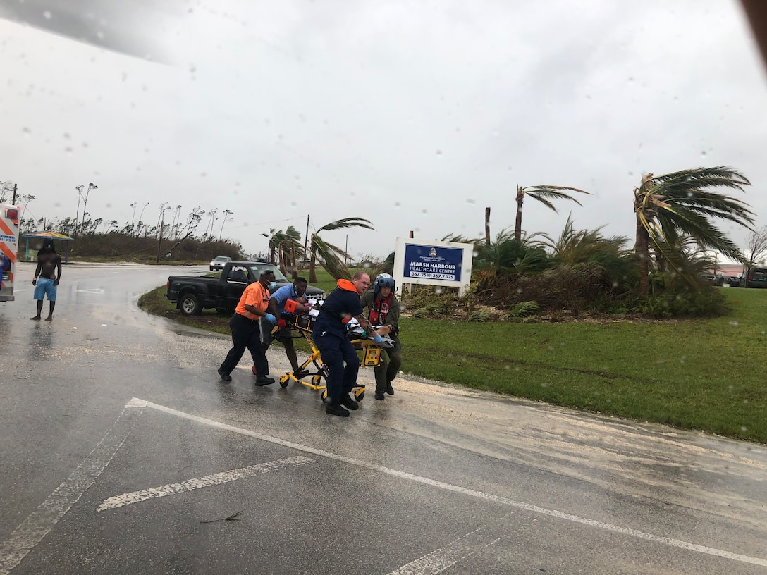 Coast Guard personnel help medevac a patient in the Bahamas during Hurricane Dorian.