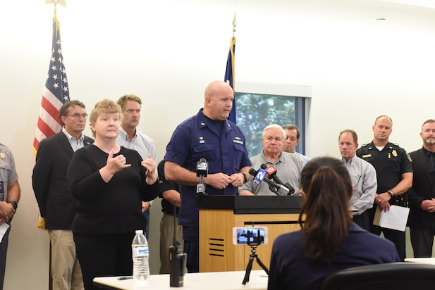 Capt. John Reed, Commander of Coast Guard Sector Charleston delivers safety messages and the current condition of the Port of Charleston during a press briefing at the Charleston County Emergency Operations Center on Tuesday Sept. 3, 2019.
