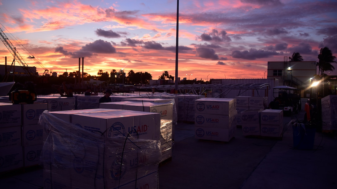Members of a Coast Guard Maintenance Augmentation Team prepare supplies at Coast Guard Sector Miami Wednesday, Sept. 4, 2019 for Coast Guard cutter crews from Key West and Miami to bring to Hurricane Dorian effected areas in the Bahamas.