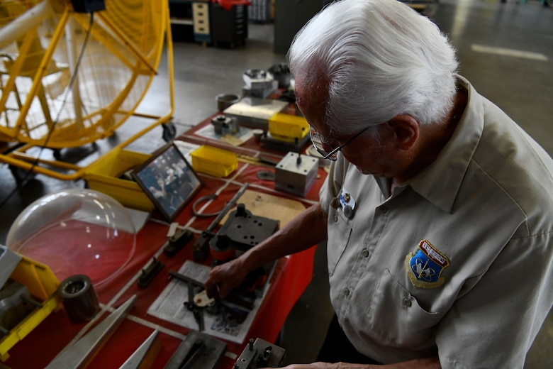 John Rumpf works to restore pieces of aircraft to be exhibited for the National Museum of the United States Air Force at Wright-Patterson Air Force Base, August 13 2019.  (U.S. Air Force photo / Darrius A. Parker)