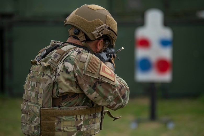 Col. Troy Pananon, 100th Air Refueling Wing commander, shoots an M4 Carbine during shoot, move and communicate training with Airmen from the 100th Security Forces Squadron at RAF Mildenhall, England, Aug. 30, 2019. Airmen from 100th SFS are RAF Mildenhall's first line of defense against any adversary and are highly trained in law enforcement and they are combat arms specialist prepared to protect and serve their fellow Airmen around-the-clock. They have similar responsibilities as civilian officers, including responding to emergencies, directing traffic and investigating crimes on base. (U.S. Air Force photo by Senior Airman Luke Milano)