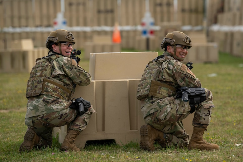 Chief Master Sgt. Kathi Glascock, left, 100th Air Refueling Wing command chief, and Col. Troy Pananon, 100th ARW commander, participate in shoot, move and communicate training with Airmen from the 100th Security Forces Squadron at RAF Mildenhall, England, Aug. 30, 2019. The purpose of the training was for the defenders to demonstrate their advanced combat skills for the commander and command Chief. (U.S. Air Force photo by Senior Airman Luke Milano)