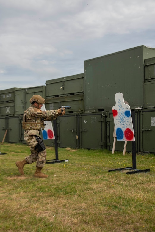 Col. Troy Pananon, 100th Air Refueling Wing commander shoots an M9 pistol during shoot, move and communicate training with Airmen from the 100th Security Forces Squadron at RAF Mildenhall, England, Aug. 30, 2019. Airmen from 100th SFS are RAF Mildenhall's first line of defense against any adversary and are highly trained law enforcement and they are combat arms specialists prepared to protect and serve their fellow Airmen around-the-clock. They have similar responsibilities as civilian officers, including responding to emergencies, directing traffic and investigating crimes on base. (U.S. Air Force photo by Senior Airman Luke Milano)