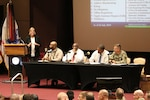 Panel members speak with AMCOM 101 event attendees