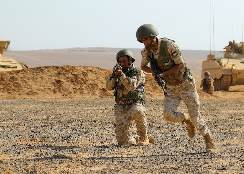 Royal Jordanian Army soldiers from the 39th Mechanized Infantry Battalion conduct dismounted maneuvers as they bound toward an objective, an urban assault training village, Sept. 2, 2019. The situational training exercise was one of many events being conducted between allied and coalition partners during Eager Lion 2019, U.S. Central Command's premiere exercise in the Levant region.