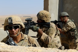 Royal Jordanian Army Soldiers from the 39th Mechanized Infantry Battalion, and the U.S. Army's 3rd Armored Brigade Combat Team, 4th Infantry Division, provide security during a situational training exercise- part of Eager Lion 2019- at an urban assault training village near Amman, Jordan, Sept. 2, 2019. In its ninth year, Eager Lion is U.S. Central Command's premiere exercise in the Levant region and provides U.S., Jordanian and 23 other participating nations' armed forces the opportunity to improve their ability to operate in a coalition-type environment.