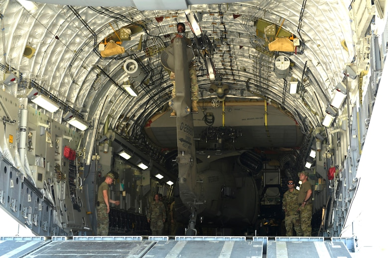 Soldiers from the 1st Battalion 228th Aviation Regiment prepare to remove a broken UH-60 Blackhawk form a C-17 Globemaster III, Aug. 26, 2019, at Soto Cano Air Base, Honduras. During a mission to support the USNS Comfort, the UH-60 crew performed a precautionary landing in an austere environment in Costa Rica. After inspecting the Blackhawk, the crew determined that aircraft was not safe to fly. Joint service members from Joint Task Force - Bravo worked together, with the assistance of a C-17 Globemaster III from U.S. Transportation Command, to return the broken helicopter back to Soto Cano. (U.S. Army photo by Martin Chahin)
