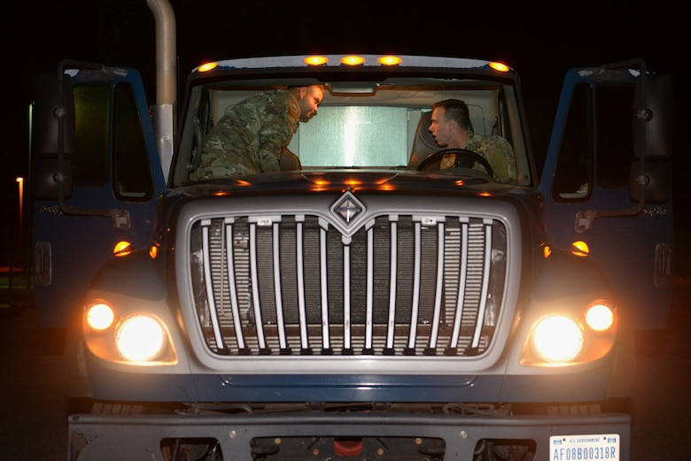Senior Airman Cameron Hurst and Trevor Stover, 81st Logistics Readiness Squadron ground transportation specialists, prepare to leave the 81st LRS compound on Keesler Air Force Base, Mississippi, September 4, 2019. Airmen from the 81st LRS palletized emergency medical equipment, such as blankets, litters and beds, and drove the gear more than 10 hours to MacDill Air Force Base, Florida, as part of the relief efforts for Hurricane Dorian. The 81st LRS worked with the 6th LRS at MacDill to get the equipment shipped through ground transportation instead of through airlift therefore saving delivery time to get the life-saving equipment to those in need. (Airman 1st Class Spencer Tobler)