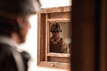 A U.S. Marine with 3rd Battalion, 7th Marine Regiment, 1st Marine Division, observes his Marines during counter improvised explosive device training at Marine Corps Air Ground Combat Center, Twentynine Palms, Calif., July 25, 2019. The training was designed to improve the confidence and proficiency in the skill sets Marines and sailors need to operate in an urban environment. (U.S. Marine Corps photo by Lance Cpl. Colton Brownlee)