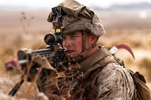 A U.S. Marine with 3rd Battalion, 7th Marine Regiment, 1st Marine Division, sights in on a target during counter improvised explosive device training at Marine Corps Air Ground Combat Center, Twentynine Palms, Calif., July 25, 2019. The training was designed to improve the confidence and proficiency in the skill sets Marines and sailors need to operate in an urban environment. (U.S. Marine Corps photo by Lance Cpl. Colton Brownlee)
