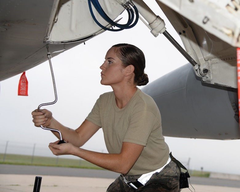 A picture of U.S. Air Force Airman 1st Class Michele Sangillo, crew chief with the New Jersey Air National Guard's 177th Fighter Wing, working on a 177FW F-16C Fighting Falcon.