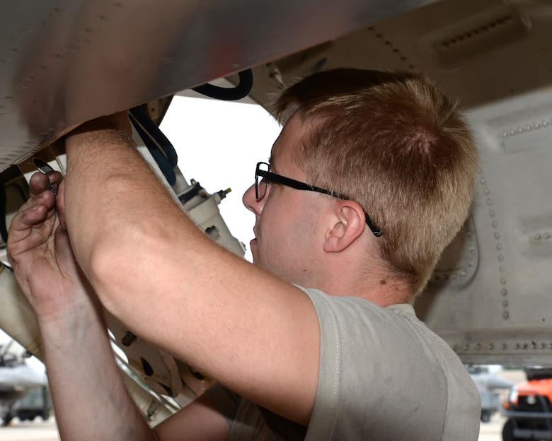A picture of U.S. Air Force Senior Airman Jakob Ackerman, crew chief with the New Jersey Air National Guard's 177th Fighter Wing, working on a 177FW F-16C Fighting Falcon.