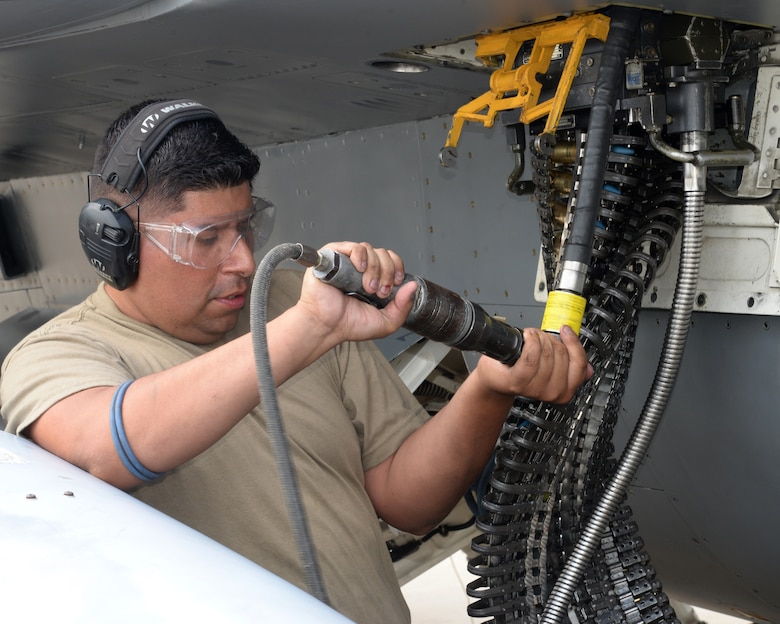 A picture of U.S. Air Force Staff Sgt. Daniel Umana, weapons loader with the New Jersey Air National Guard's 177th Fighter Wing, working on a 177Fw F-16C Fighting Falcon.
