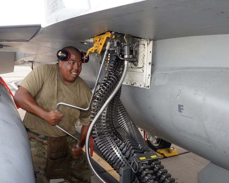 A picture of U.S. Air Force Staff Sgt. Maurice Poole, weapons loader with the New Jersey Air National Guard's 177th Fighter Wing, working on a 177FW F-16C Fighting Falcon.