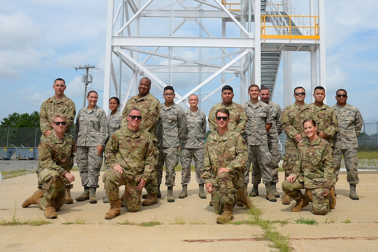 A picture of Members of four teams from the 177th Fighter Wing's inaugural Combined Combat Skills Challenge posing for a group photo at the Warren Grove Bombing Range in Ocean County, N.J.