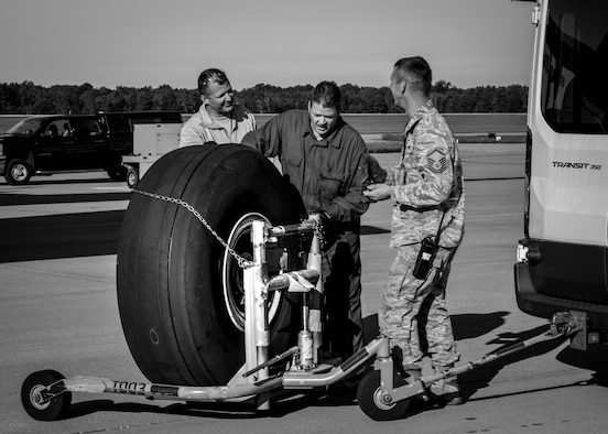 Members from the 910th Maintenance Group spent the morning changing a tire on an aircraft due to the normal wear and tear of routine takeoffs and landings.