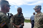 Maj. Christopher J. Ahlemeyer, of the Rhode Island National Guard (right), speaks with Commodore Tellis A. Bethel, commander, Royal Bahamas Defence Force (center), and Col. Andrew J. Chevalier, of the Rhode Island National Guard, following a joint forces assault exercise Tradewinds 2018. Tradewinds is a U.S. Southern Command sponsored exercise that provides participating Caribbean nations the opportunity to improve security and disaster response capabilities.