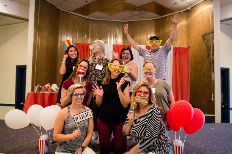 Members of the Kirtland Spouses Club pose in the photo booth during a membership carnival kick off event at Kirtland Air Force Base, N.M.