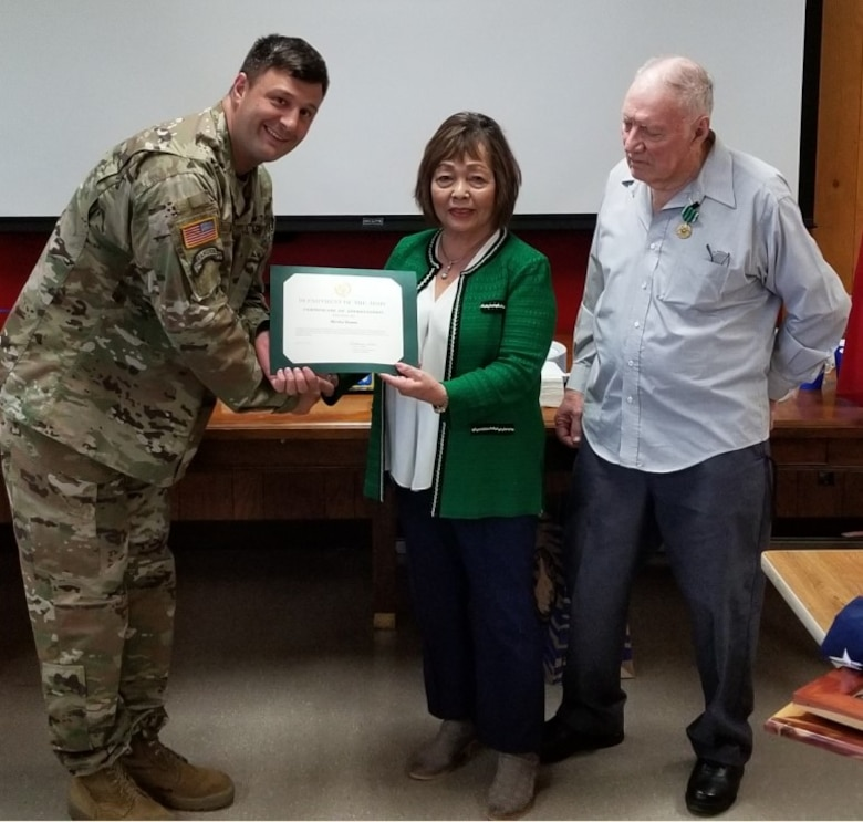 Deputy District Commander Lt. Col. Nathan Molica presents Mrs. Hamm with her Certificate of Appreciation.