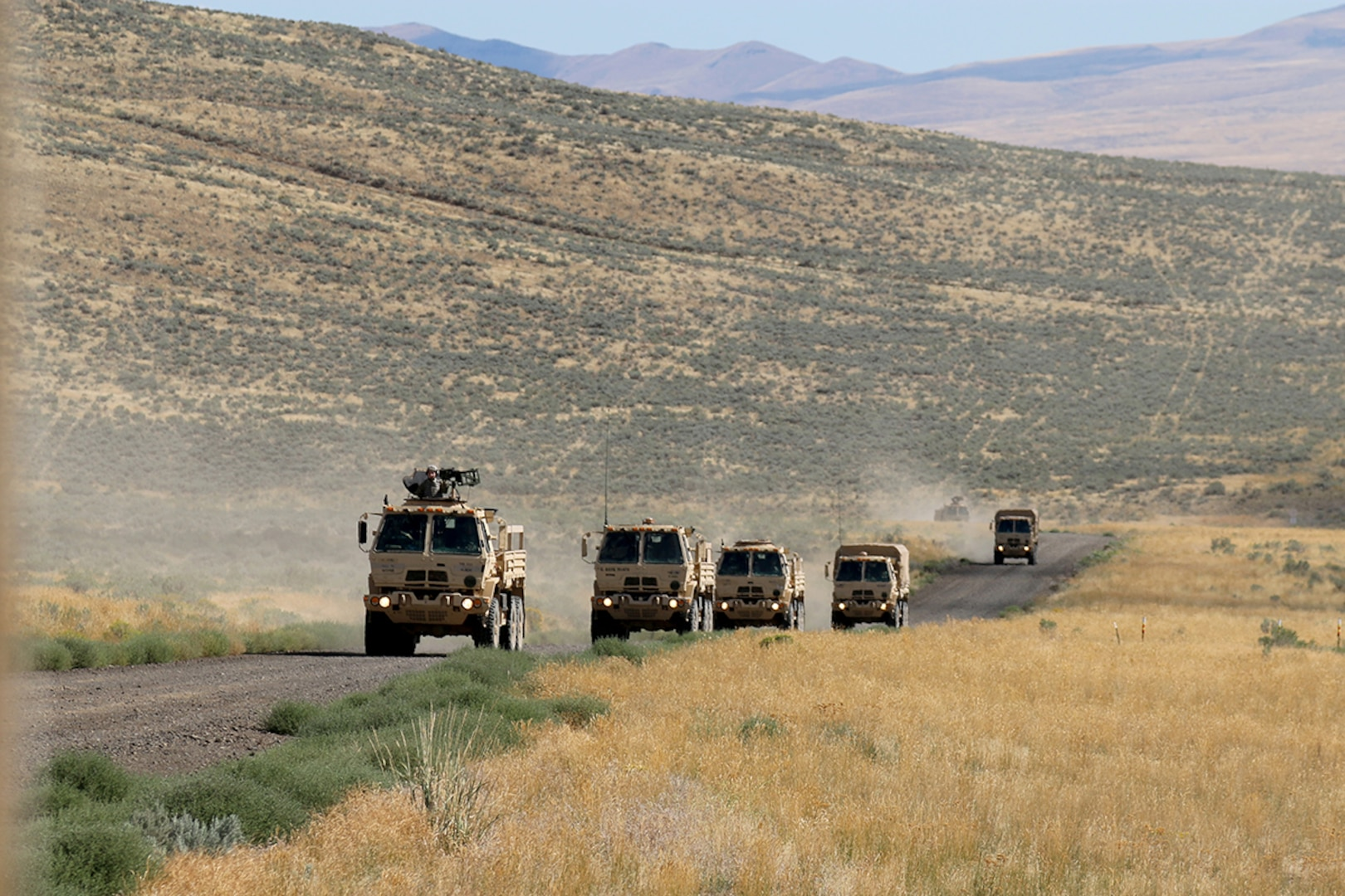 Illinois Army National Guard Soldiers from the 1844th Transportation Company convoy to their IED lane training as part of Rising Thunder 2019