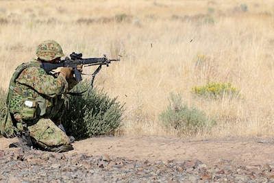 A soldier from the Japan Ground Self-Defense Force opens fire on his target in a live fire exercise during Rising Thunder, Sep. 1, at the Yakima Training Center in Yakima, Washington.