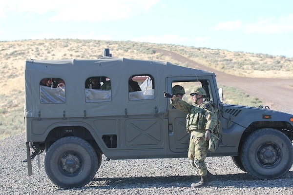 A Japanese infantryman gives a directional hand signal to his driver, Sept. 2, while on Range 15 at Yakima Training Center, during exercise Rising Thunder 19.
