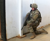 A Soldier from the 2nd Battalion, 130th Infantry Regiment, 33rd Infantry Brigade Combat Team, Illinois Army National Guard, posts guard at the entrance of a training building while the rest of his team completes room clearances during Rising Thunder 19 at the Yakima Training Center in Yakima, Washington, Sept. 1, 2019.