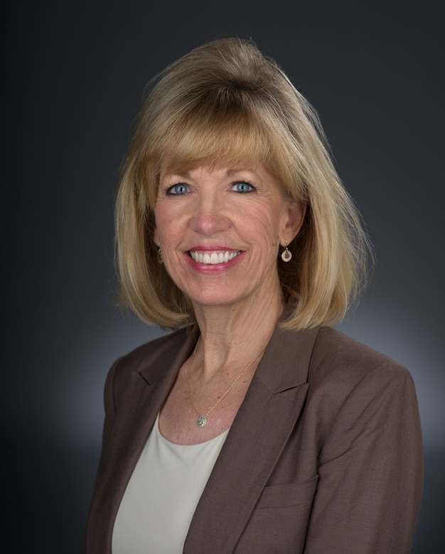 Sandy Person, Air Force-level civic leader, poses for formal photo at Travis Air Force Base, California. Civic leaders like Person engage with senior leadership to communicate mutual interest, challenges and concerns. (U.S. Air Force Photo by Heide Couch)