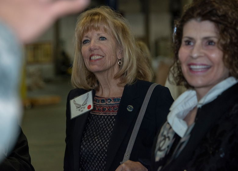 Sandy Person, left, Air Force-level civic leader, and Heidi Campini, 60th Medical Support Squadron honorary commander, participate in a tour through the 60th Aerial Port Squadron warehouse Oct. 12, 2018, Travis Air Force Base, California. Civic leaders and honorary commanders tour the base quarterly to promote relationships with Team Travis leadership, and communicate mutual interest, challenges and concerns. (U.S. Air Force Photo by Heide Couch)