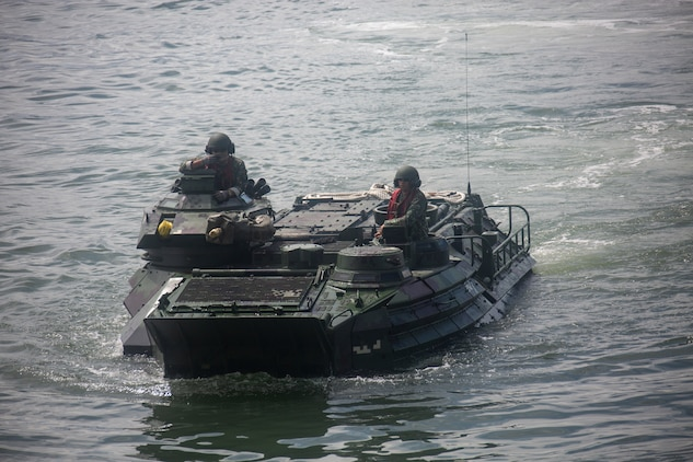 Philippine and U.S. Marines drive a Philippine assault amphibious vehicle onto the BRP Davao Del Sur (LD-602) during an AAV subject matter expert exchange in Subic Bay, Philippines, Aug. 31, 2019. The U.S. Marine Corps has partnered with the Philippine Marine Corps for the last eight years to develop skill sets and policies to enable the Philippine Navy and Marine Corps to conduct amphibious operations. This SMEE was a milestone in these efforts, marking the first time that Philippine forces launched their AAVs from a Philippine Navy amphibious ship and transited from ship to shore. The U.S. Marines are from AAV Company, 4th Marine Regiment, 3rd Marine Division. (U.S. Marine Corps photos by Lance Cpl. Jacob Hancock)