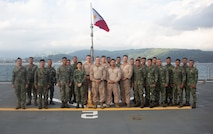 U.S. Marines pose with Philippine Marines for a celebratory end-of-training photo aboard the BRP Davao Del Sur (LD-602) during an assault amphibious vehicle subject matter expert exchange in Subic Bay, Philippines, Sept. 4, 2019. The U.S. Marine Corps has partnered with the Philippine Marine Corps for the last eight years to develop skill sets and policies to enable the Philippine Navy and Marine Corps to conduct amphibious operations. This SMEE was a milestone in these efforts, marking the first time that Philippine forces launched their AAVs from a Philippine Navy amphibious ship and transited from ship to shore. The U.S. Marines are from AAV Company, 4th Marine Regiment, 3rd Marine Division. (U.S. Marine Corps photos by Lance Cpl. Jacob Hancock)
