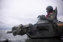 Philippine Marine Corps 1st Lt. Marever Taghap sits in the turret of an assault amphibious vehicle that is being driven by U.S. Marines during an AAV subject matter expert exchange in Subic Bay, Philippines, Sept. 1, 2019. The U.S. Marine Corps has partnered with the Philippine Marine Corps for the last eight years to develop skill sets and policies to enable the Philippine Navy and Marine Corps to conduct amphibious operations. This SMEE was a milestone in these efforts, marking the first time that Philippine forces launched their AAVs from a Philippine Navy amphibious ship and transited from ship to shore. The U.S. Marines are from AAV Company, 4th Marine Regiment, 3rd Marine Division. (U.S. Marine Corps photos by Lance Cpl. Jacob Hancock)