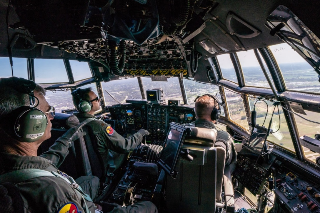 U.S. Air Force Maj. Ed Fattmann, center, a pilot assigned to the 180th Airlift Squadron, Missouri Air National Guard, takes his first flight as an aircraft commander with one eye above St. Joseph, Missouri, Sept. 4, 2019. Fattman has been a pilot with the 180th AS since 2009, but was put on 'duty not including flying' status after losing sight in his right eye from a firework misfire in 2012. For his first flight back in military status, he flew with his original crew from his first deployment to Afghanistan in 2010. (U.S. Air National Guard photo by Tech. Sgt. Patrick Evenson)
