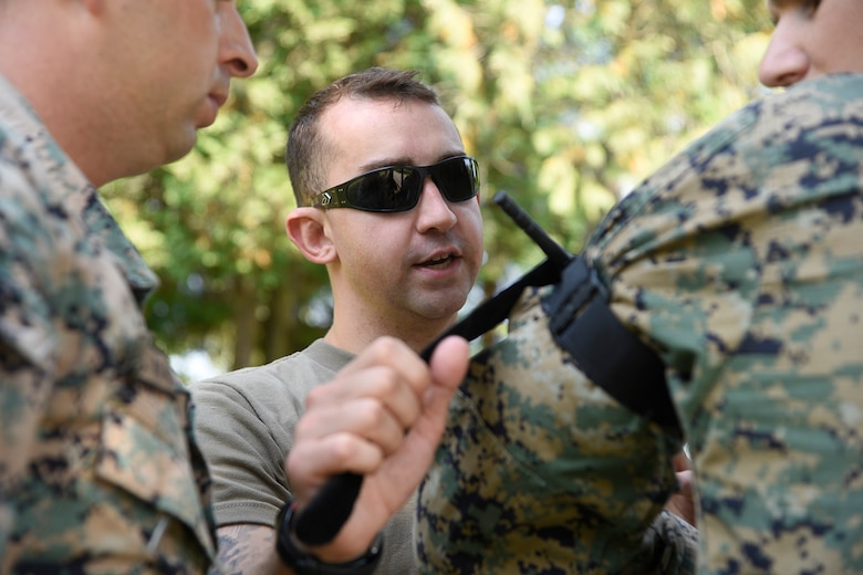 Spc. Frank Giglio, combat medic, 104th Area Support Medical Company, Maryland National Guard applies a tourniquet during a medical training exercise with the Armed Forces of Bosnia-Herzegovina, August 28, 2019, Banja Luka, Bosnia. The purpose of the training was to ensure members of the Armed Forces of Bosnia-Herzegovina are able to effectively respond to medical emergencies or casualties in combat situations. (U.S. Air National Guard photo by Staff Sgt. Enjoli Saunders)