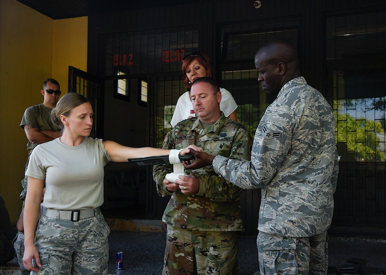 Airman 1st Class Tiffany Morse, medical technician, 175th Wing Medical Group, Maryland Air National Guard, Sgt. Michael Conlon, combat medic, 104th Area Support Medical Company, Maryland National Guard, and Airman 1st Class Geoffrey Elungata, biomedical equipment technician, 175th Medical Group, Maryland Air National Guard demonstrate proper application of a SAM splint during a medical training exercise with the Armed Forces of Bosnia-Herzegovina, August 28, 2019, Banja Luka, Bosnia.