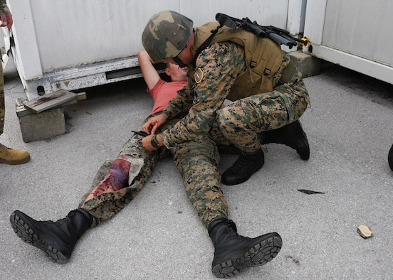 A member of the Armed Forces of Bosnia-Herzegovina applies a tourniquet to an injury during the final training exercise that simulated a real-world combat situation, August 29, 2019, Banja Luka, Bosnia. The purpose of the training was to ensure members of the Armed Forces of Bosnia-Herzegovina are able to effectively respond to medical emergencies or casualties in combat situations. (U.S. Air National Guard photo by Staff Sgt. Enjoli Saunders)
