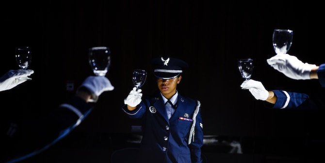 U.S. Air Force Airmen from the 52nd Fighter Wing Base Honor Guard perform a prisoner-of-war and missing-in-action presentation during the annual POW/MIA Recognition Ceremony at Spangdahlem Air Base, Germany, Sept. 6, 2019. The table was set for six to represent fallen or missing service members from the five U.S. military branches and civilians. (U.S. Air Force photo by Airman 1st Class Valerie Seelye)
