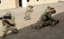 Pfc. Taylor Reed (left), joined by fellow Guardsmen with the 2nd Battalion, 130th Infantry Regiment, Illinois Army National Guard, participate in Combat Life Saver drills during Rising Thunder 19, Sept. 3, 2019 at the Yakima training Center in Yakima, Washington.