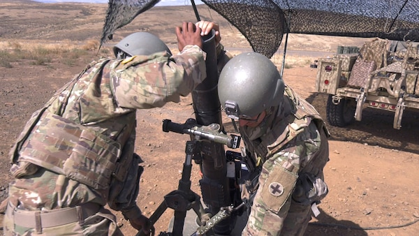 Soldiers from Headquarters and Headquarters Company, 2nd Battalion, 130th Infantry Regiment, based in Marion, Illinois, adjust a 120mm mortar tube during Rising Thunder 19.